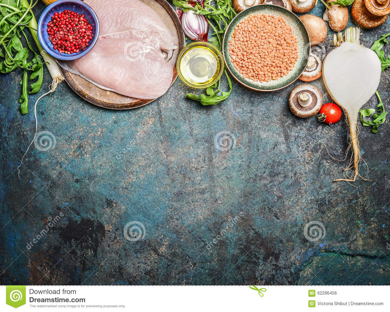 Chicken breast, red lentil, fresh vegetables and various ingredients for cooking on rustic background, top view. Horizontal border
