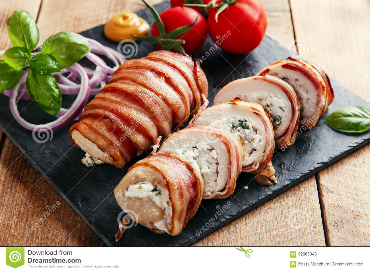 Chicken Breast Stuffed Feta Cheese And Herbs In Bacon Stock Photo ...