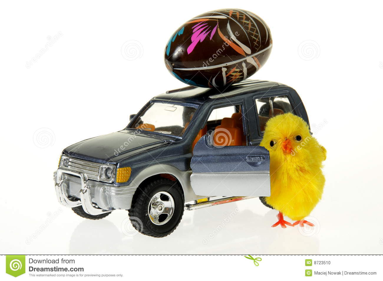 Stock Photo: Chicken at car with Easter egg on the roof