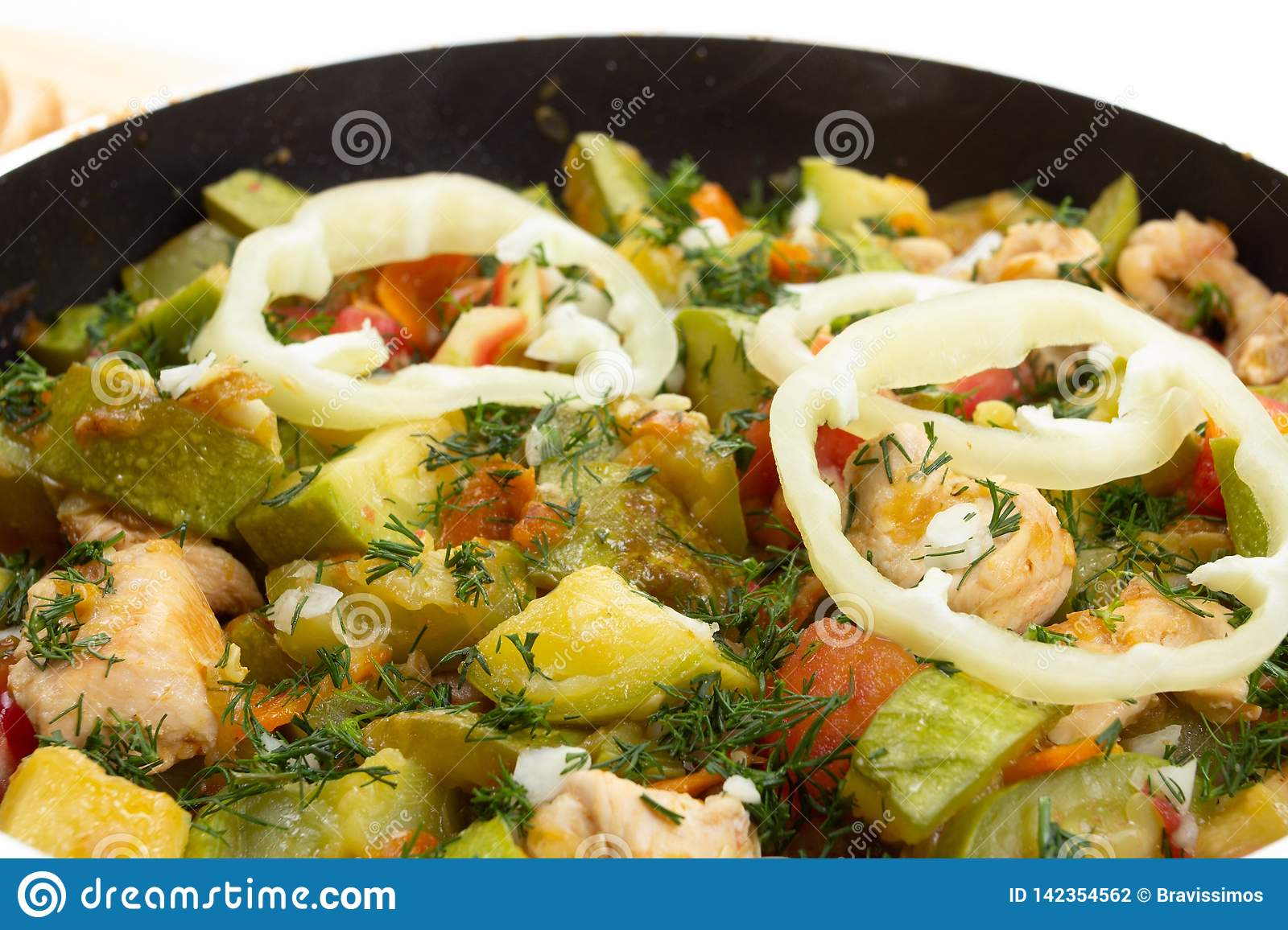 Chicken. carrot and zucchini on pan vegetable food, cooking