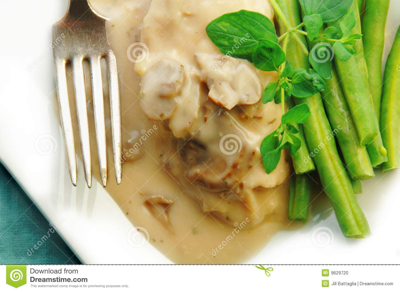 Chicken breast in a cream mushroom sauce with steamed green beans.