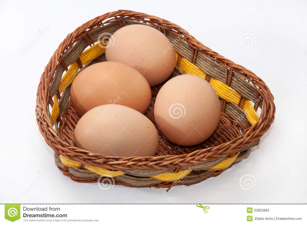 Chicken eggs in a wicker basket