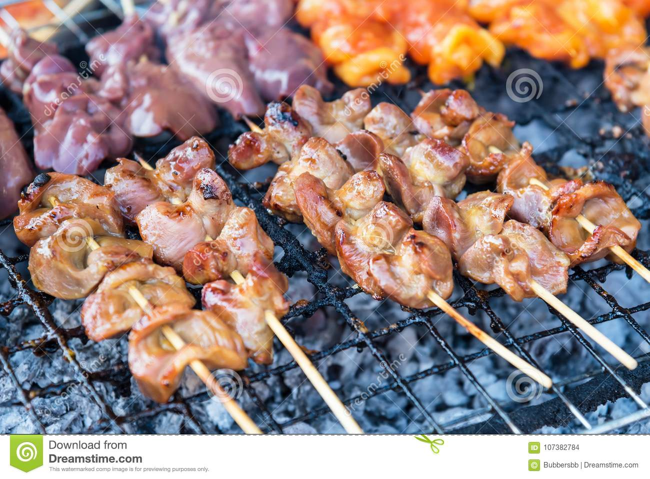 Chicken internal organs grill on charcoal stove at sattahip mark download chicken internal organs grill on charcoal stove at sattahip mark stock photo image of ccuart Choice Image