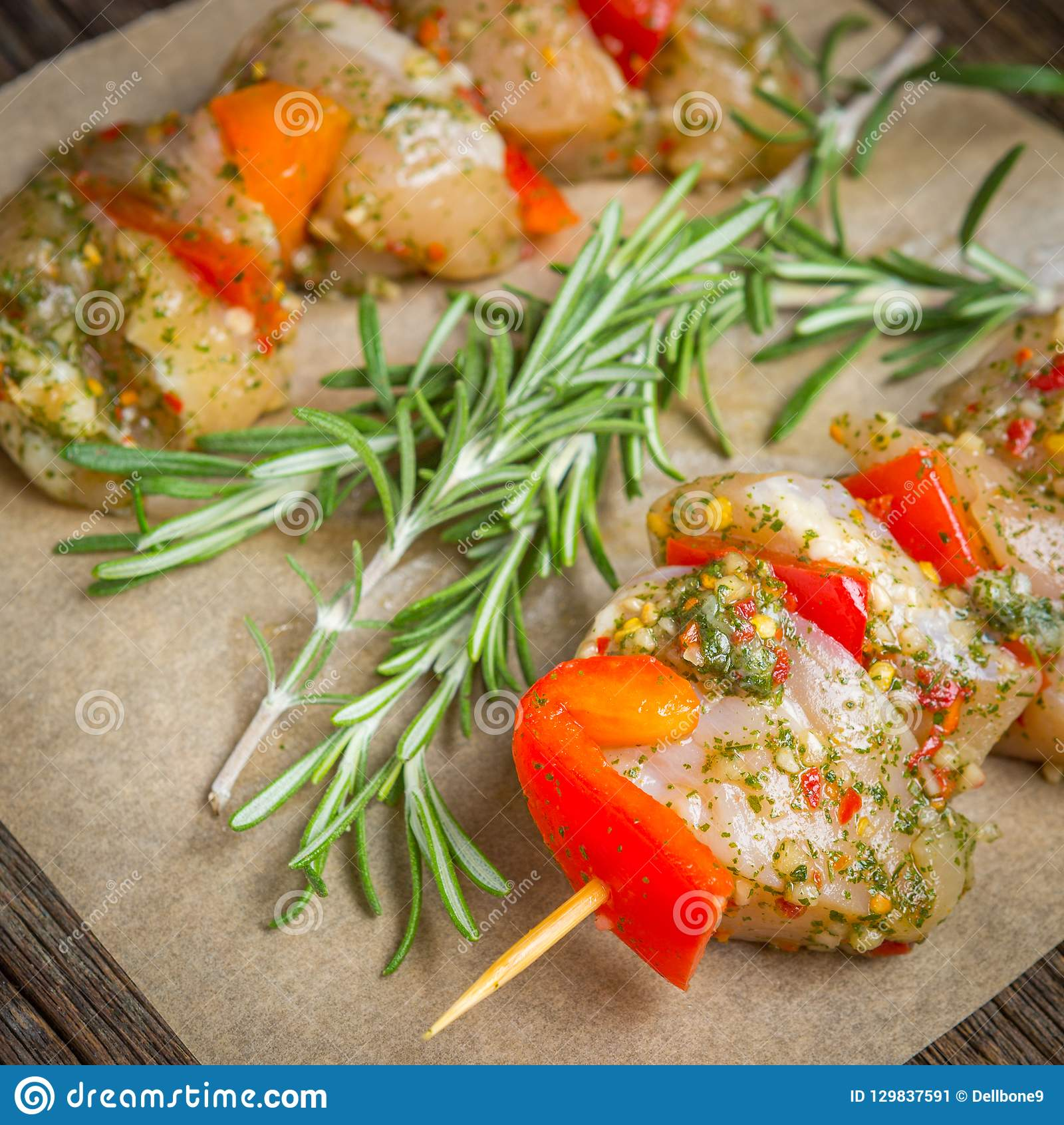 Making kebabs from chicken - raw meat on skewers