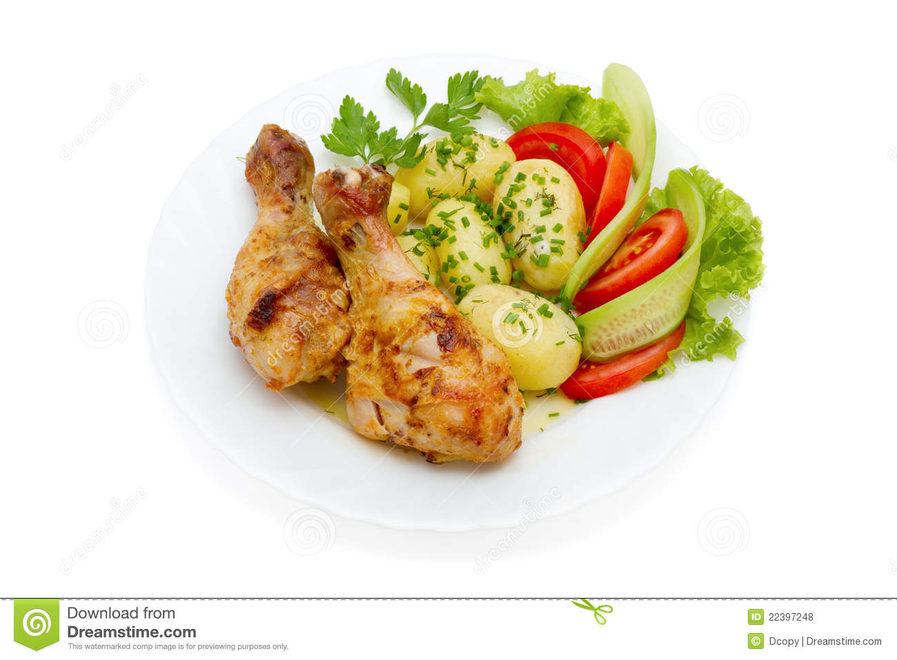 Royalty Free Stock Photos: Chicken legs, potatoes and vegetable salad
