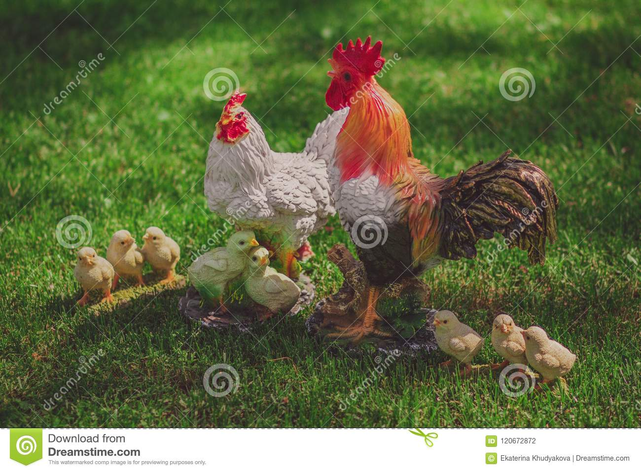Chicken model family, decorated in a garden
