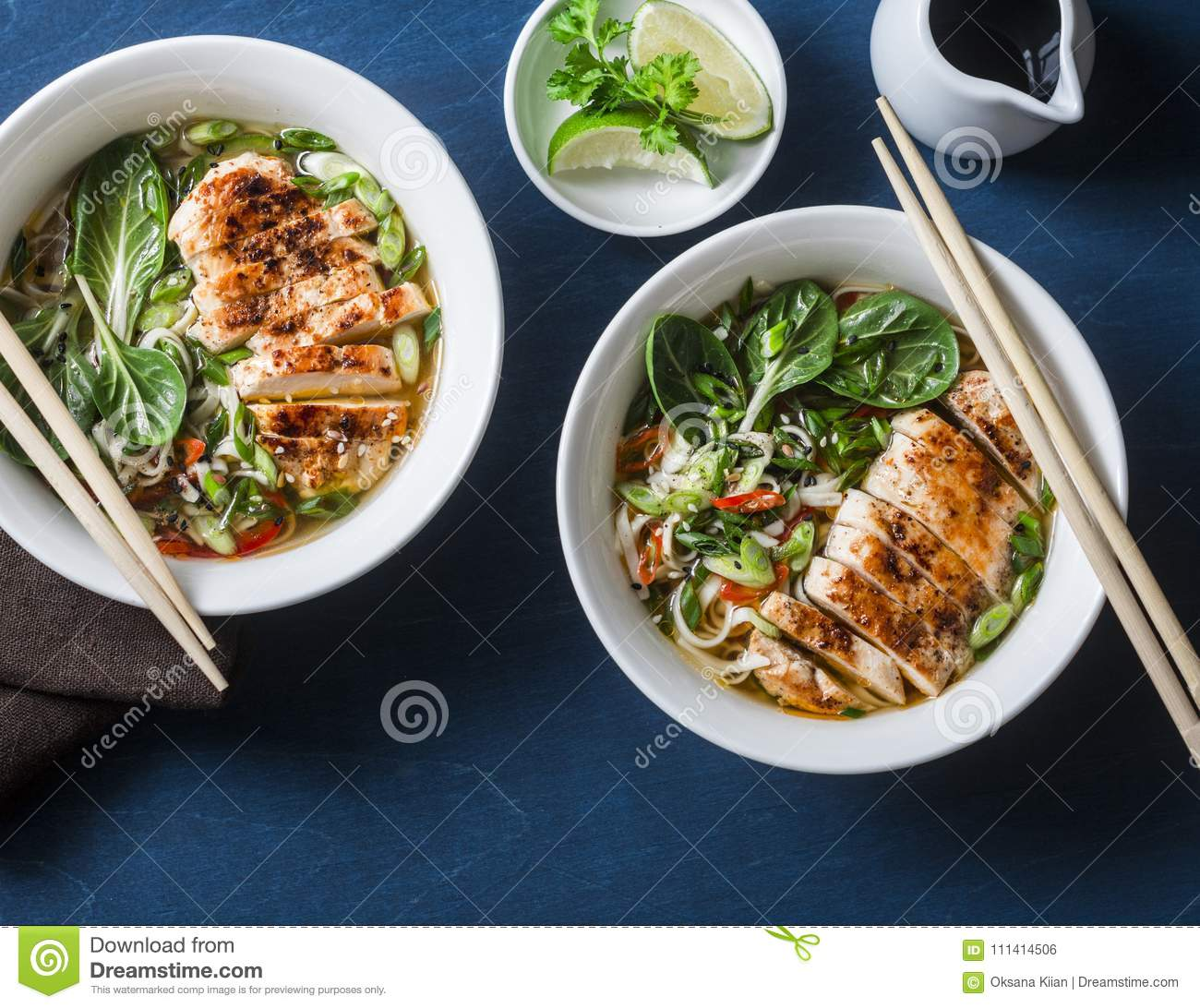 Chicken, Noodles And Vegetables Asian Style Soup On A Blue