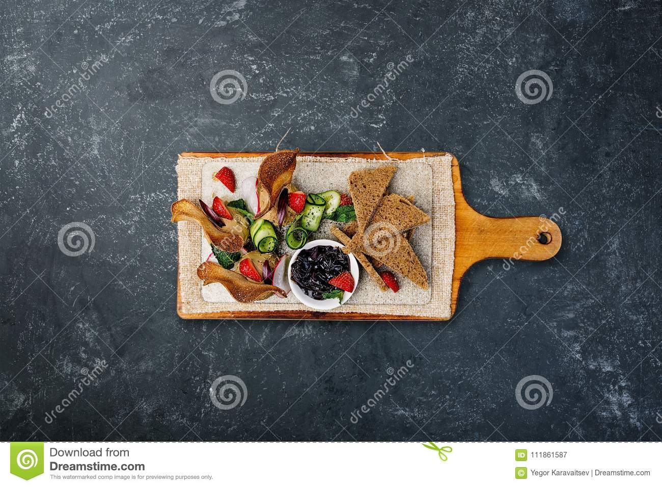 Chicken pate with plum sauce, served with croutons. Top view