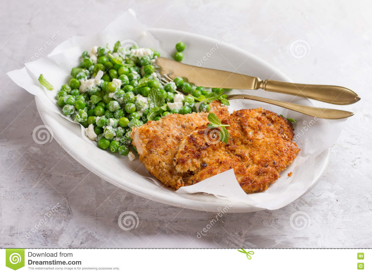 Chicken or pork schnitzel with cheese and peas salad