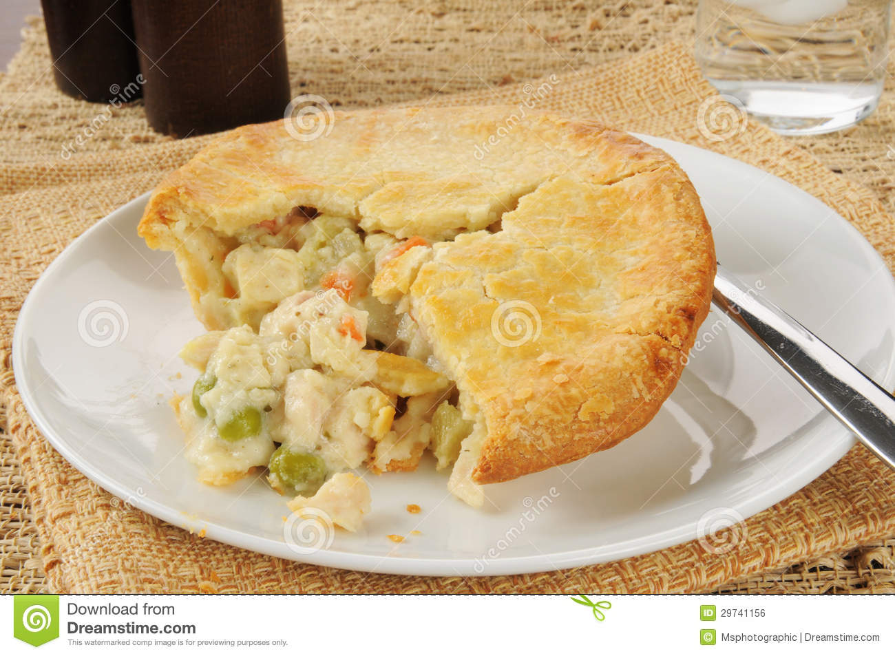 Chicken pot pie with a bite taken out.