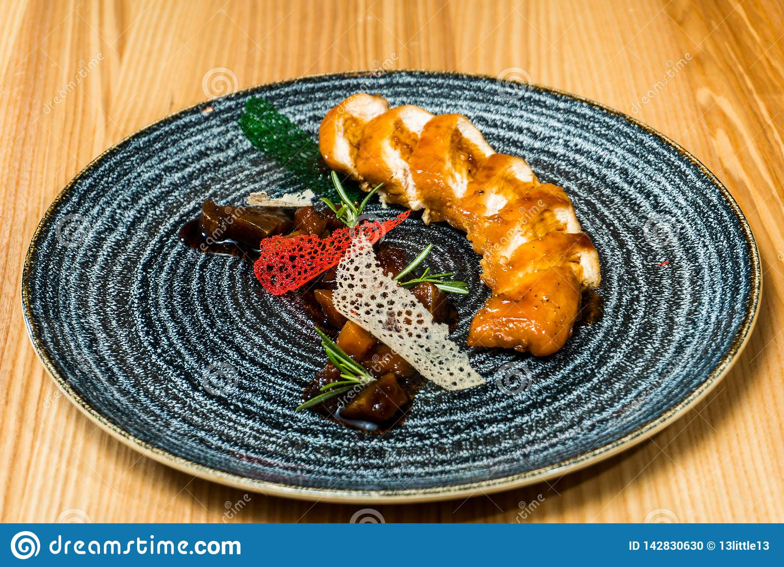 Chicken roll in a black plate