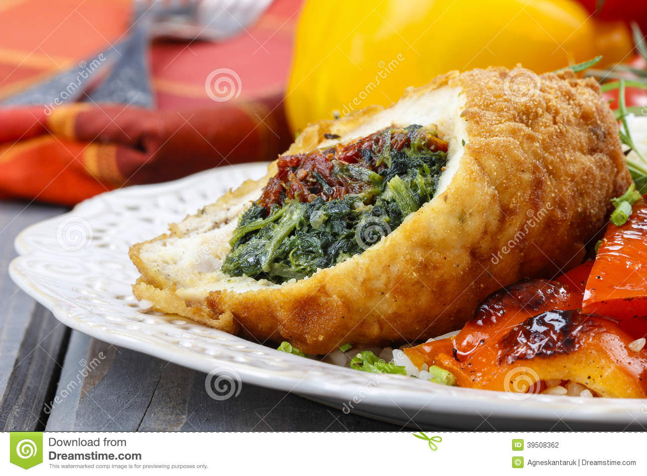Chicken roll stuffed with spinach and dried tomatoes