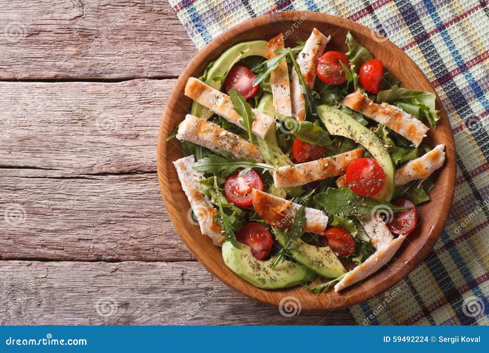 Chicken salad with avocado, arugula and tomatoes. horizontal top