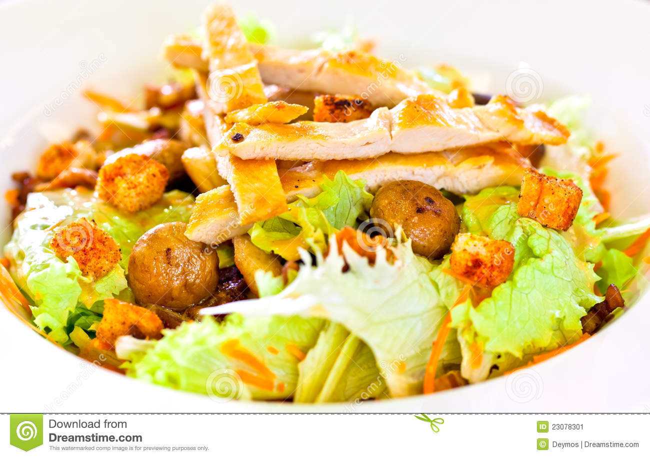 Chicken salad with grated carrots, mushrooms, bread croutons and green ...
