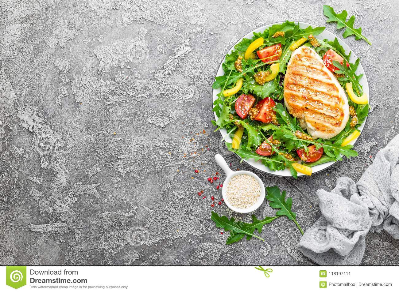 Chicken salad. Meat salad with fresh tomato, sweet pepper, arugula and grilled chicken breast. Chicken fillet with fresh vegetable