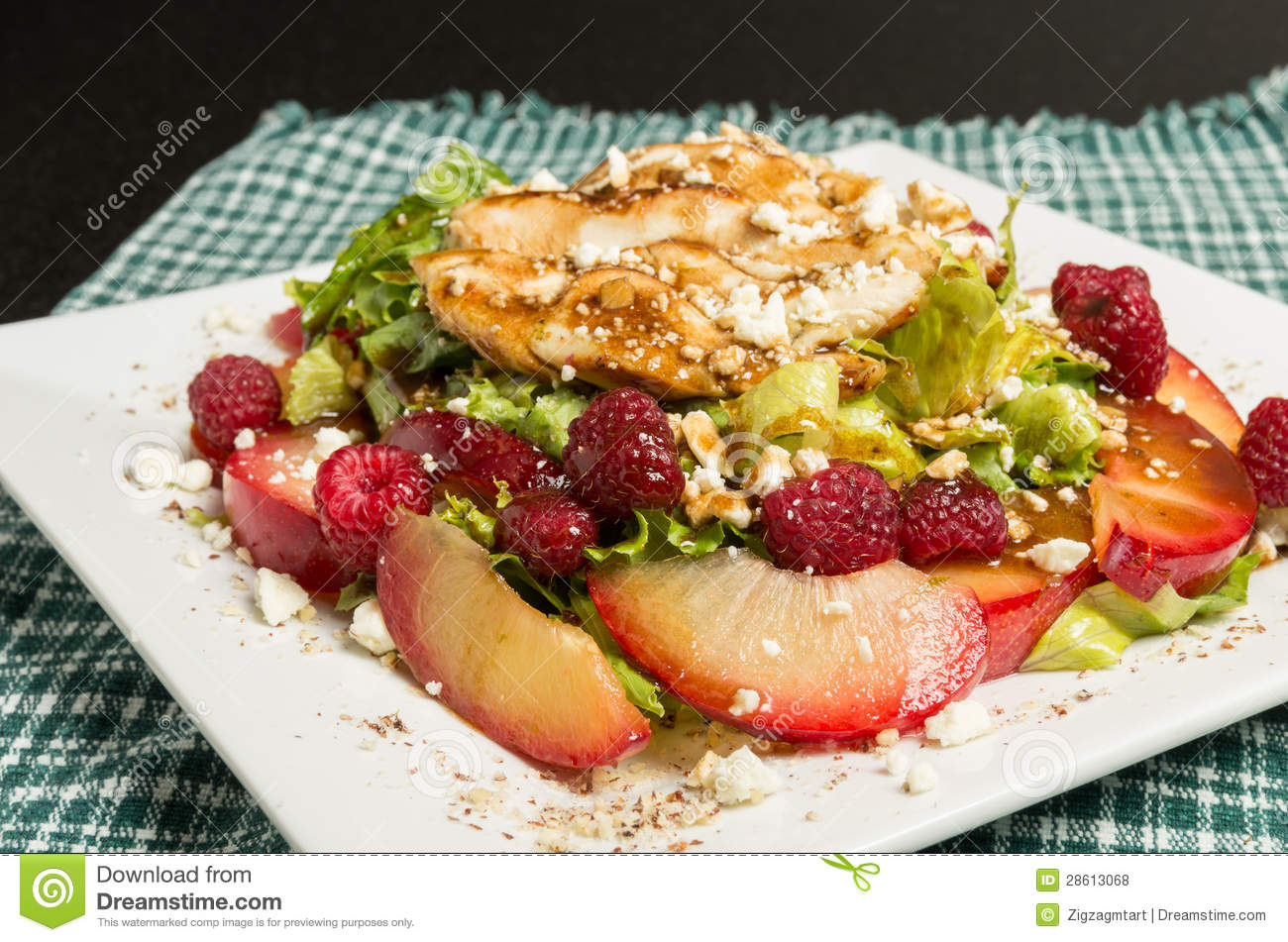 Royalty Free Stock Photos: Chicken salad with plums and raspberries
