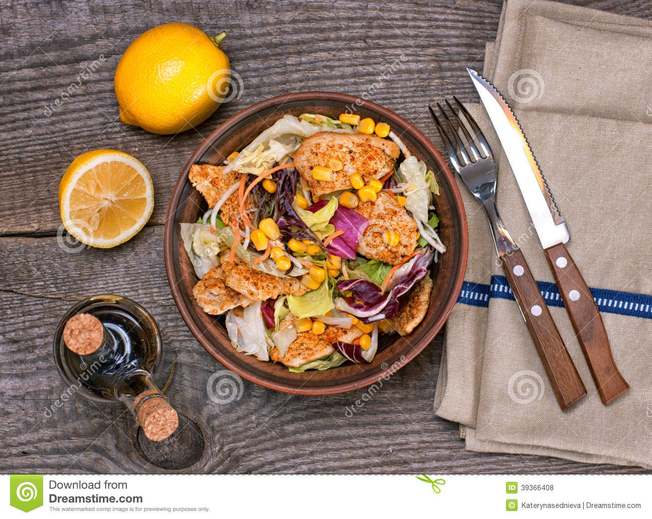 Chicken salad with sweet corn and green mix, top view