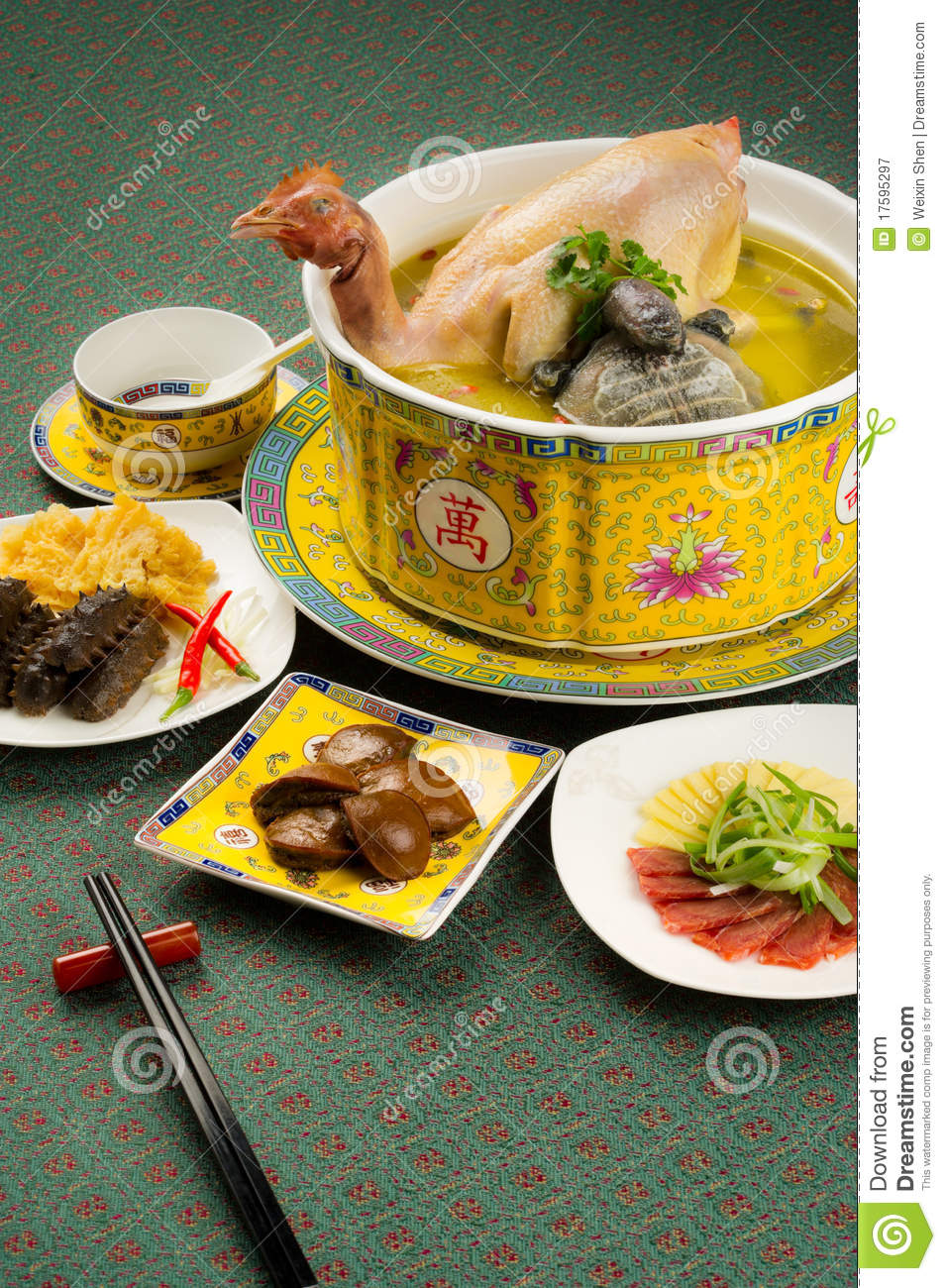 Chinese cuisine, chicken soup in the pot with food stuff.