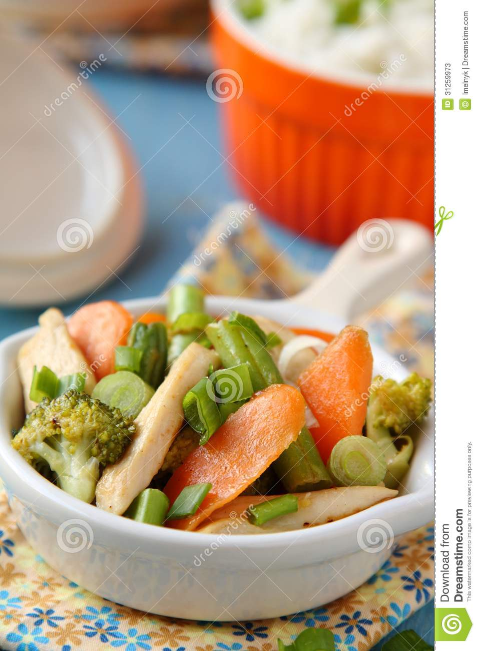 Chicken stir fry with vegetables (carrots, onions, broccoli, green ...