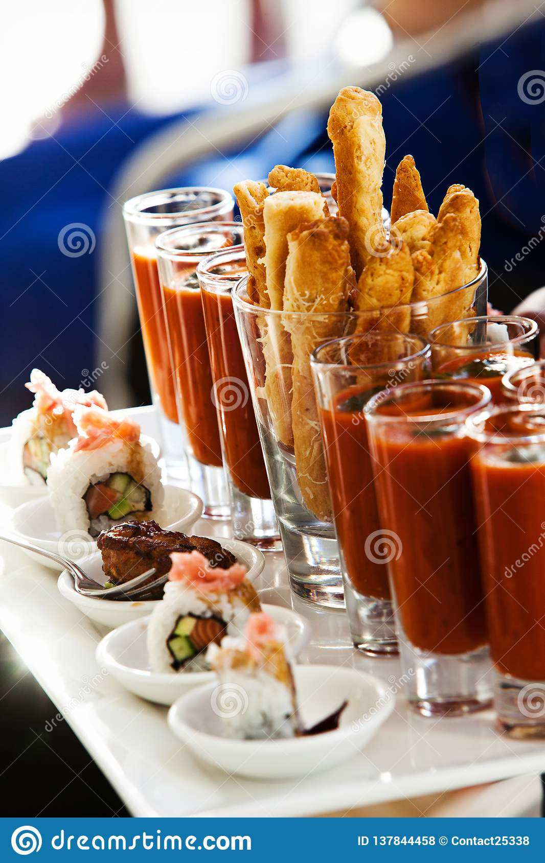 Chicken Strips with Shooter chilli tomato sushi California rolls