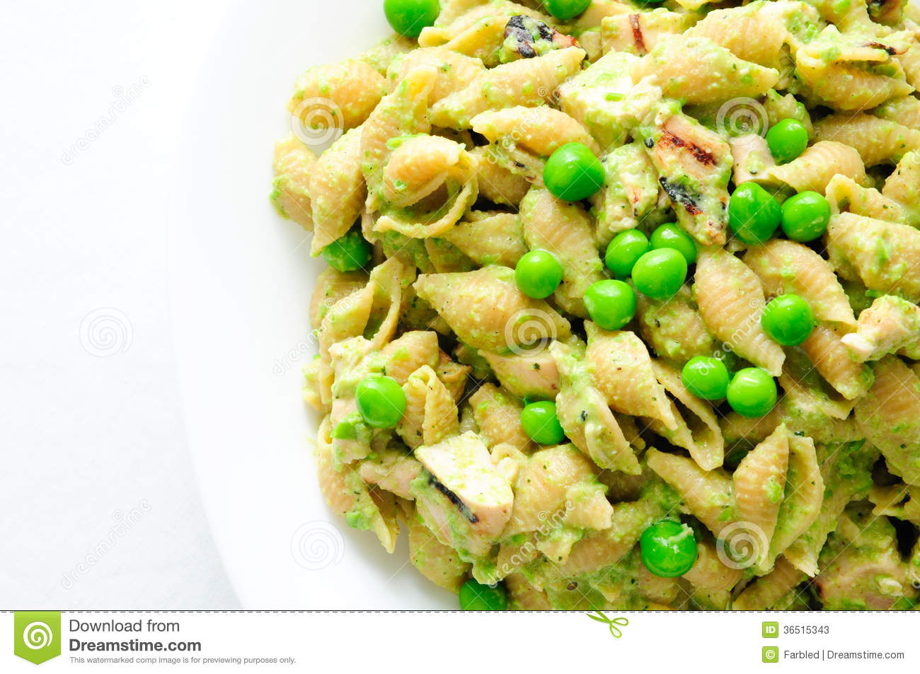 ... pesto pasta with chicken, basil and parmesan cheese and sweet peas