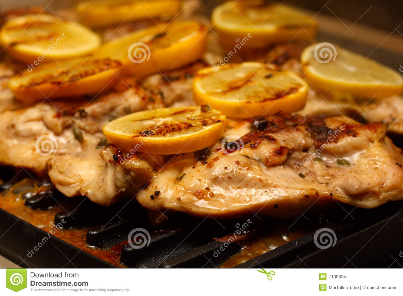 Chicken thighs on the Grill topped with lemons