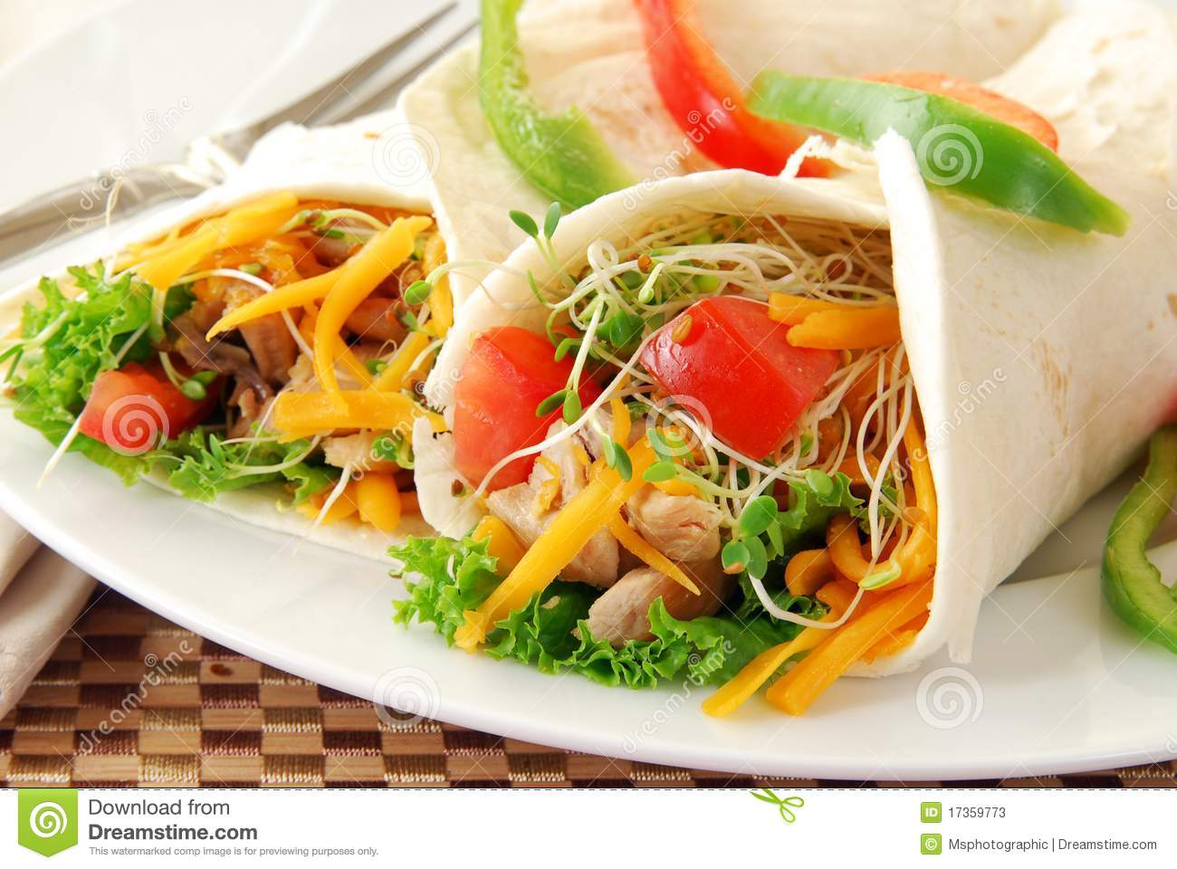 Chicken and vegetables wrapped in tortilla shells.