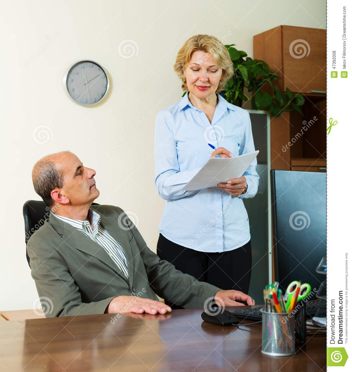 chief giving new task to mature secretary stock photo - image of