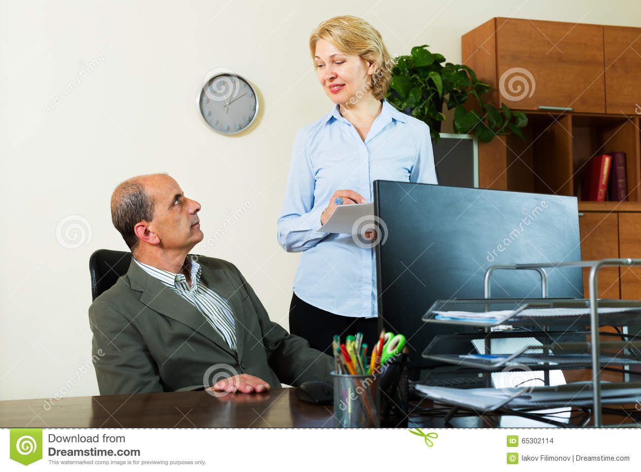 chief giving task to mature secretary stock photo - image of