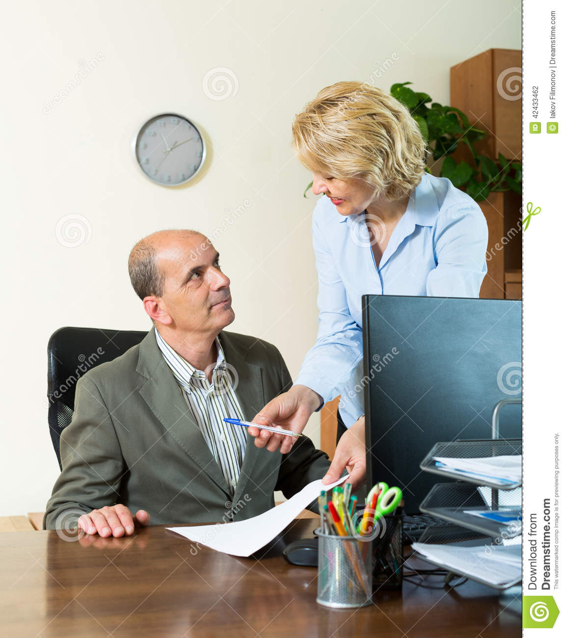 chief talking with secretary stock photo - image of interior, people