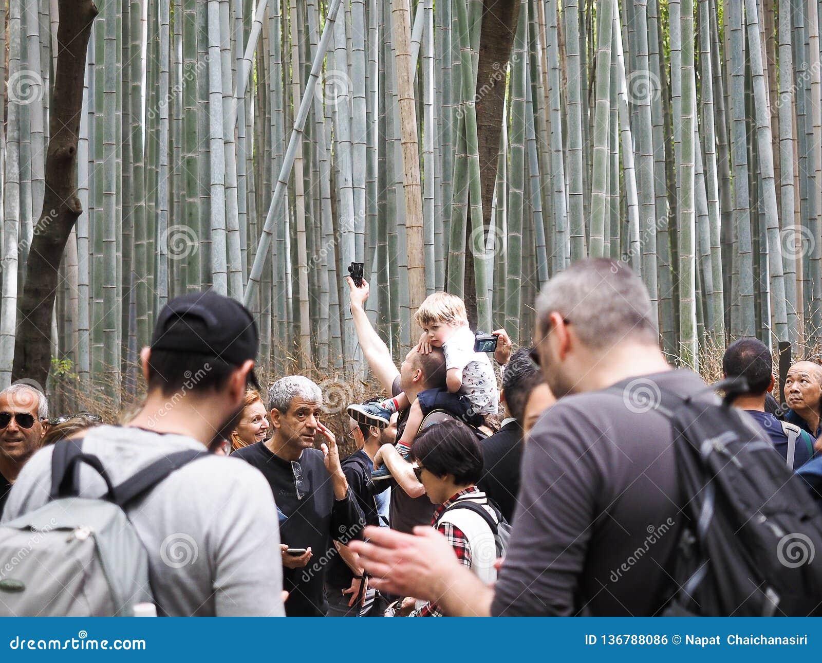 Arashiyama /kyoto, Japan - April 12, 2018 : Chikurin-no-Michi Bamboo Grove and group of tourism