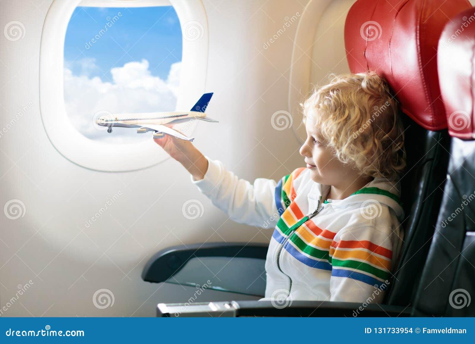 Child In Airplane Kid In Air Plane Sitting In Window Seat Flight