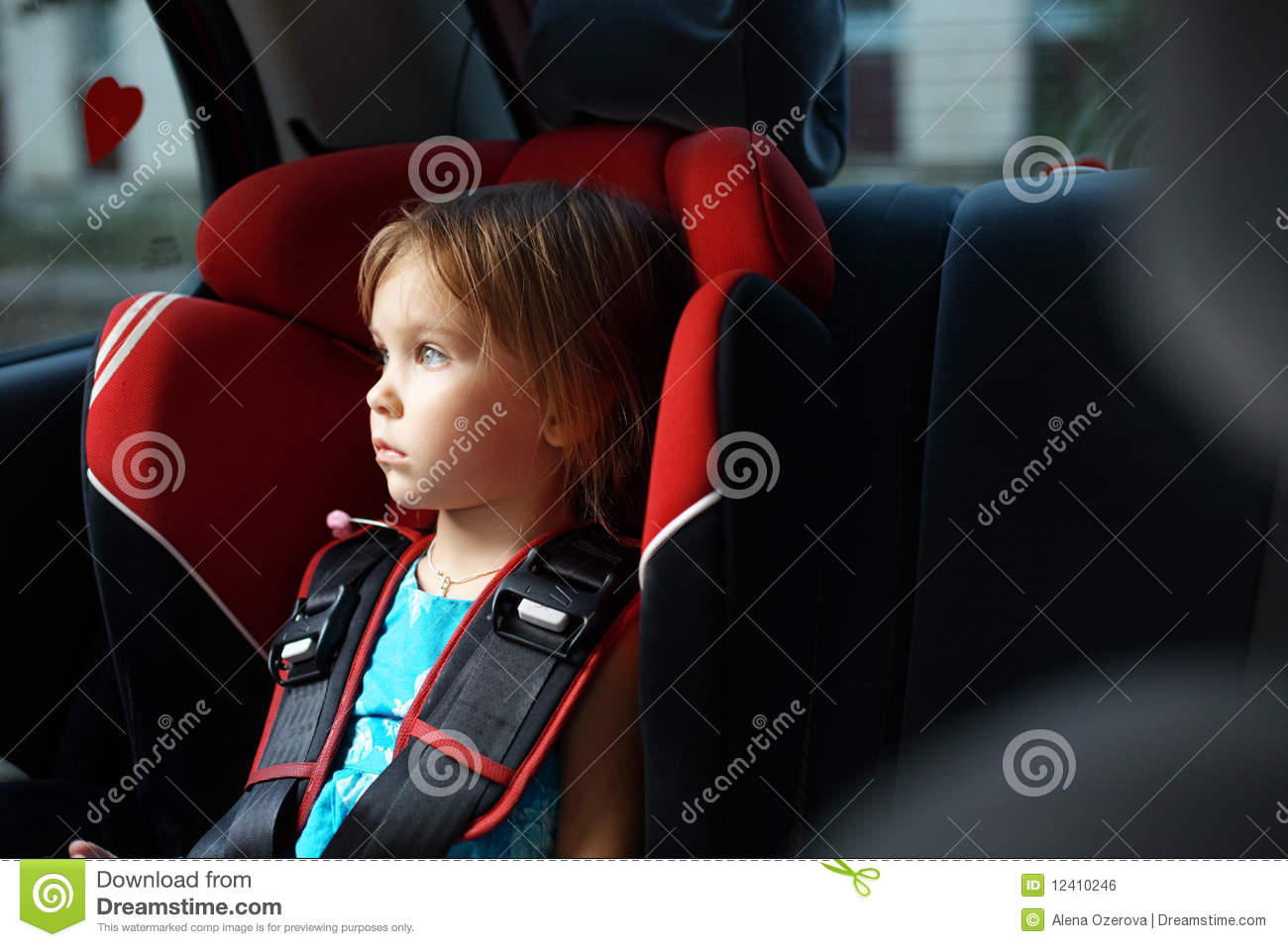 Child in auto baby seat in car