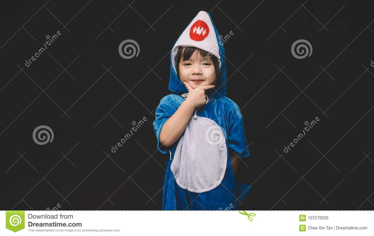 Child with baby shark costume