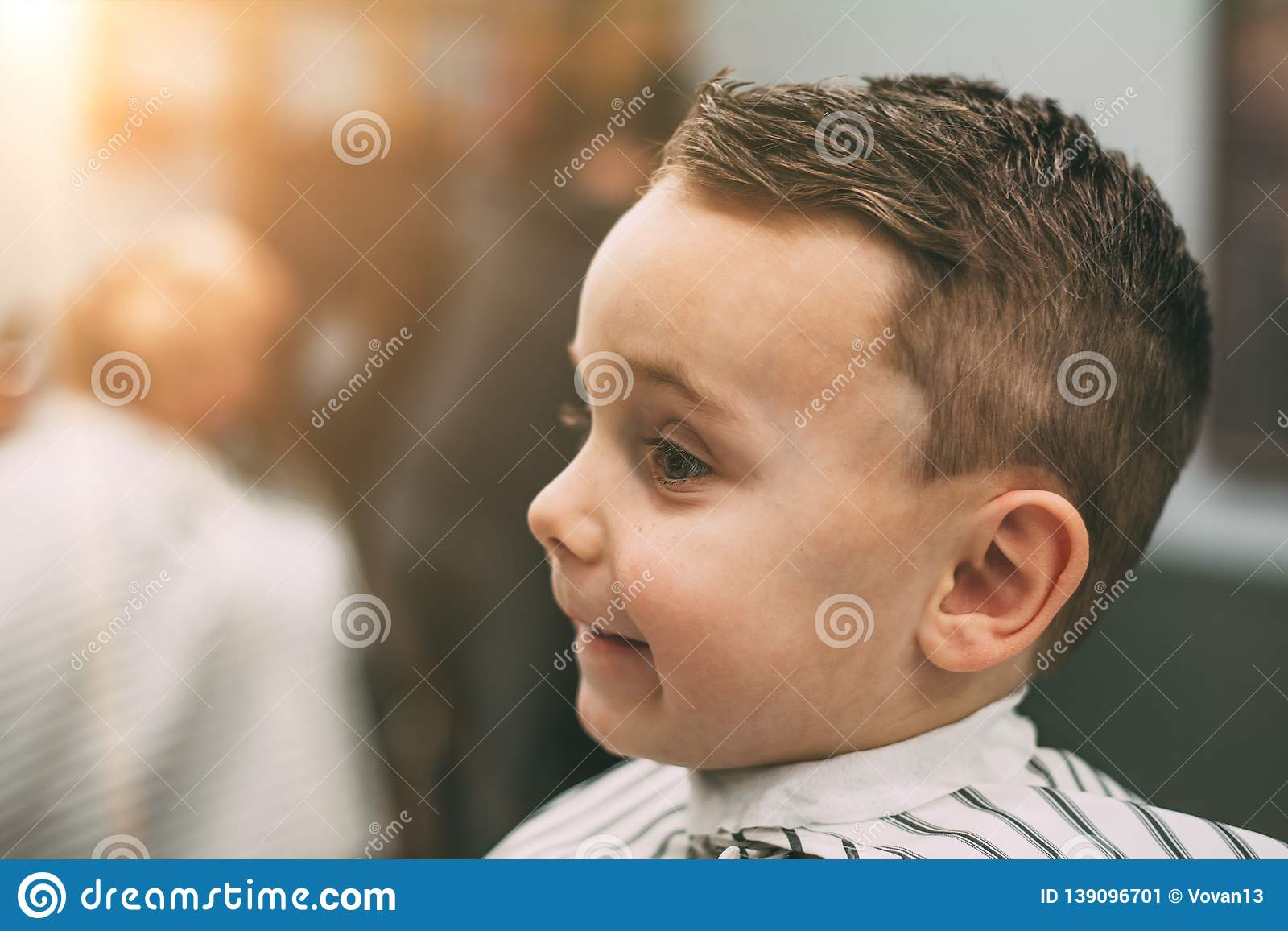 The Child Is Being Cut Hairstyles Stock Image - Image of ...