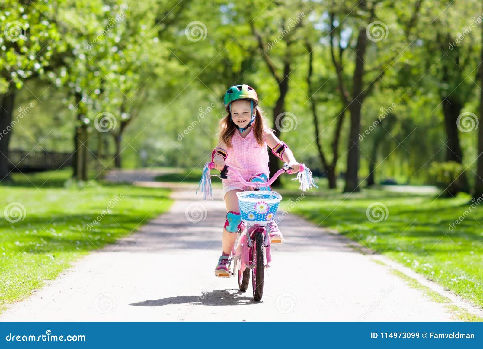 Child On Bike. Kids Ride Bicycle. Girl Cycling. Stock Image - Image of  lifestyle, helmet: 114973099