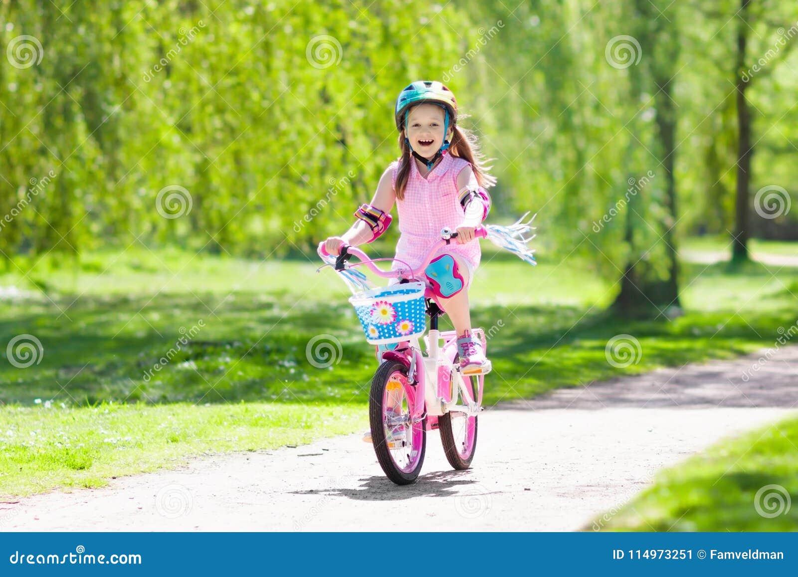 Child On Bike  Kids Ride Bicycle  Girl Cycling  Stock Image