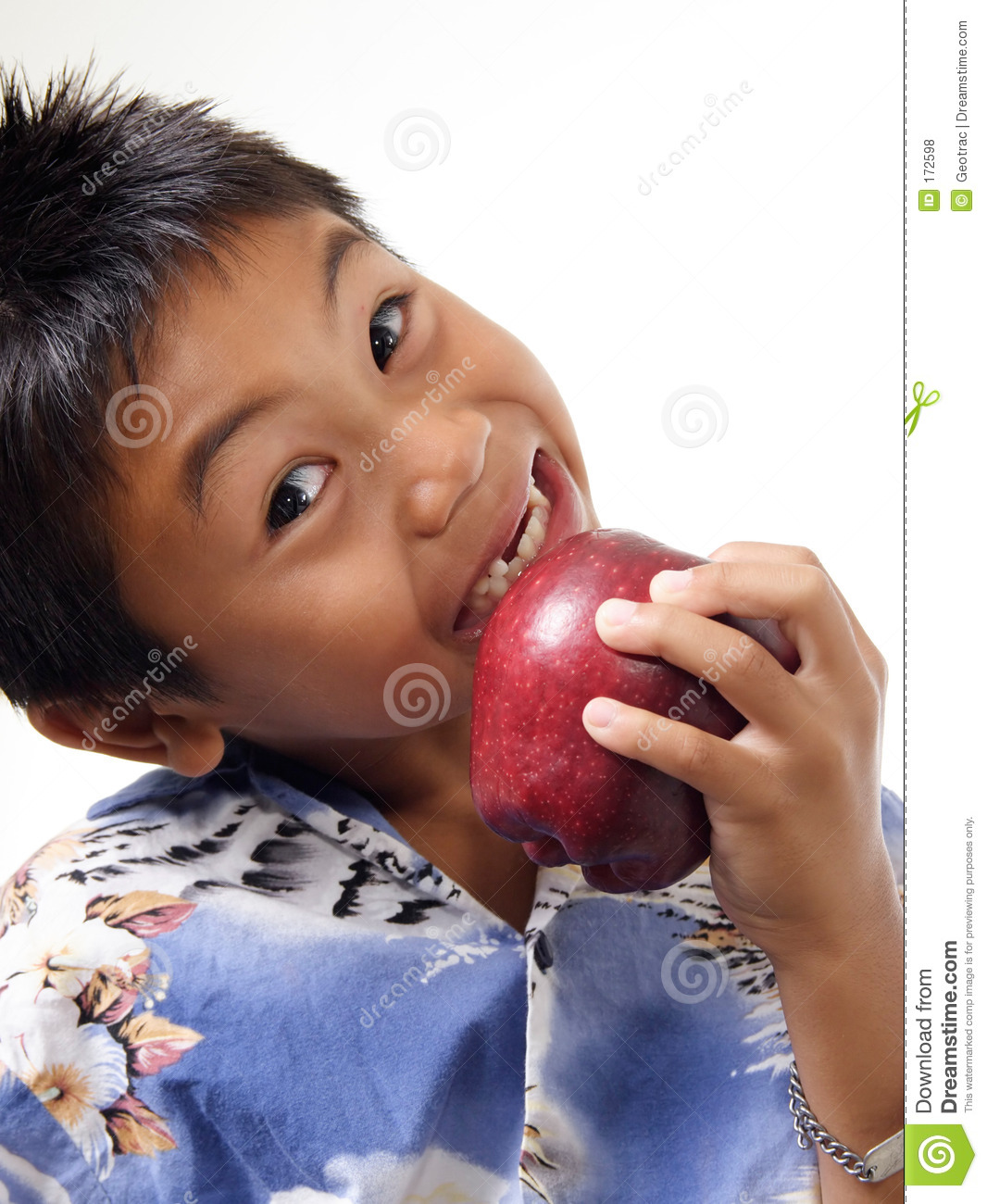 Child biting on apple