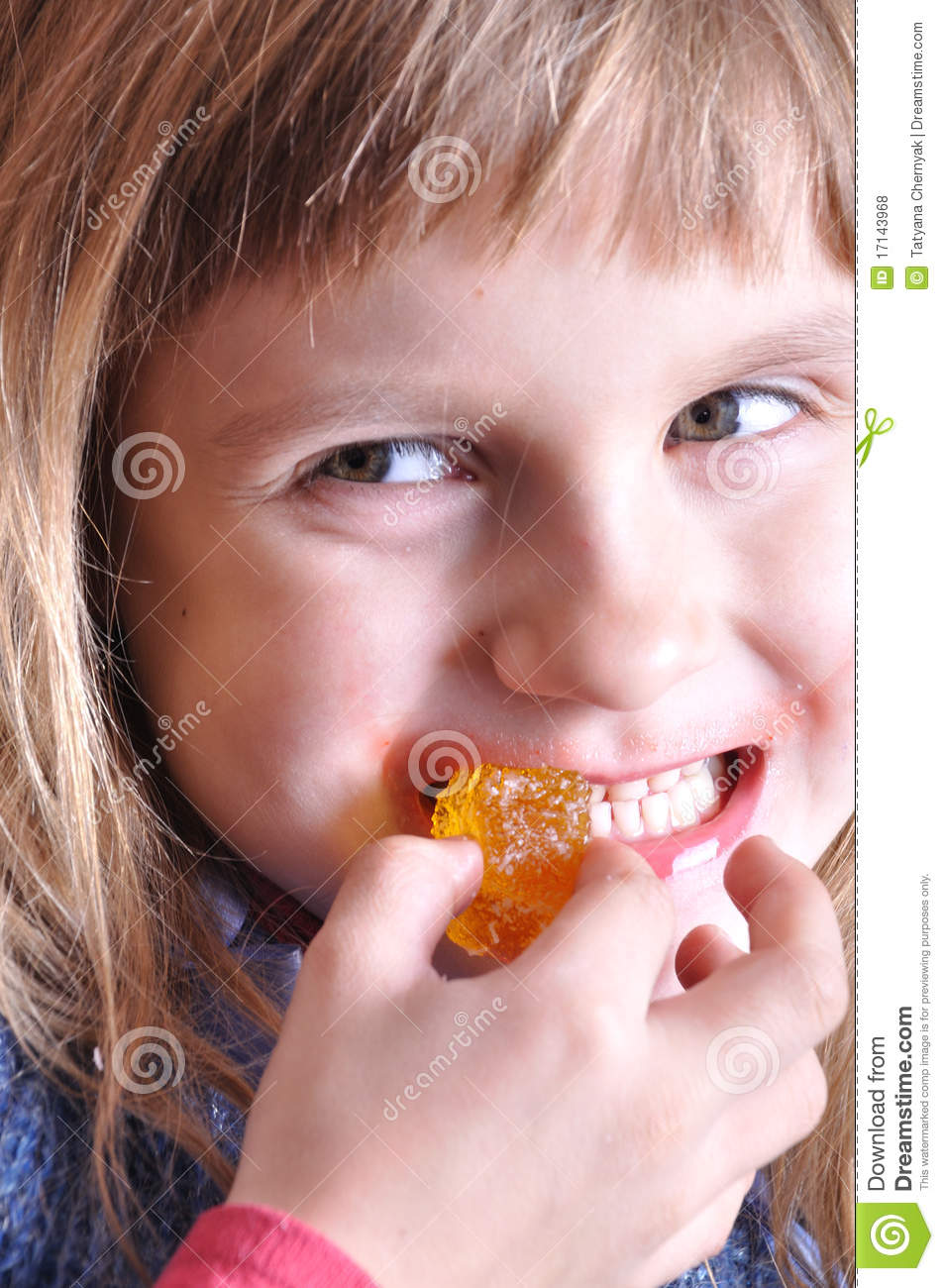 Child biting a sweet
