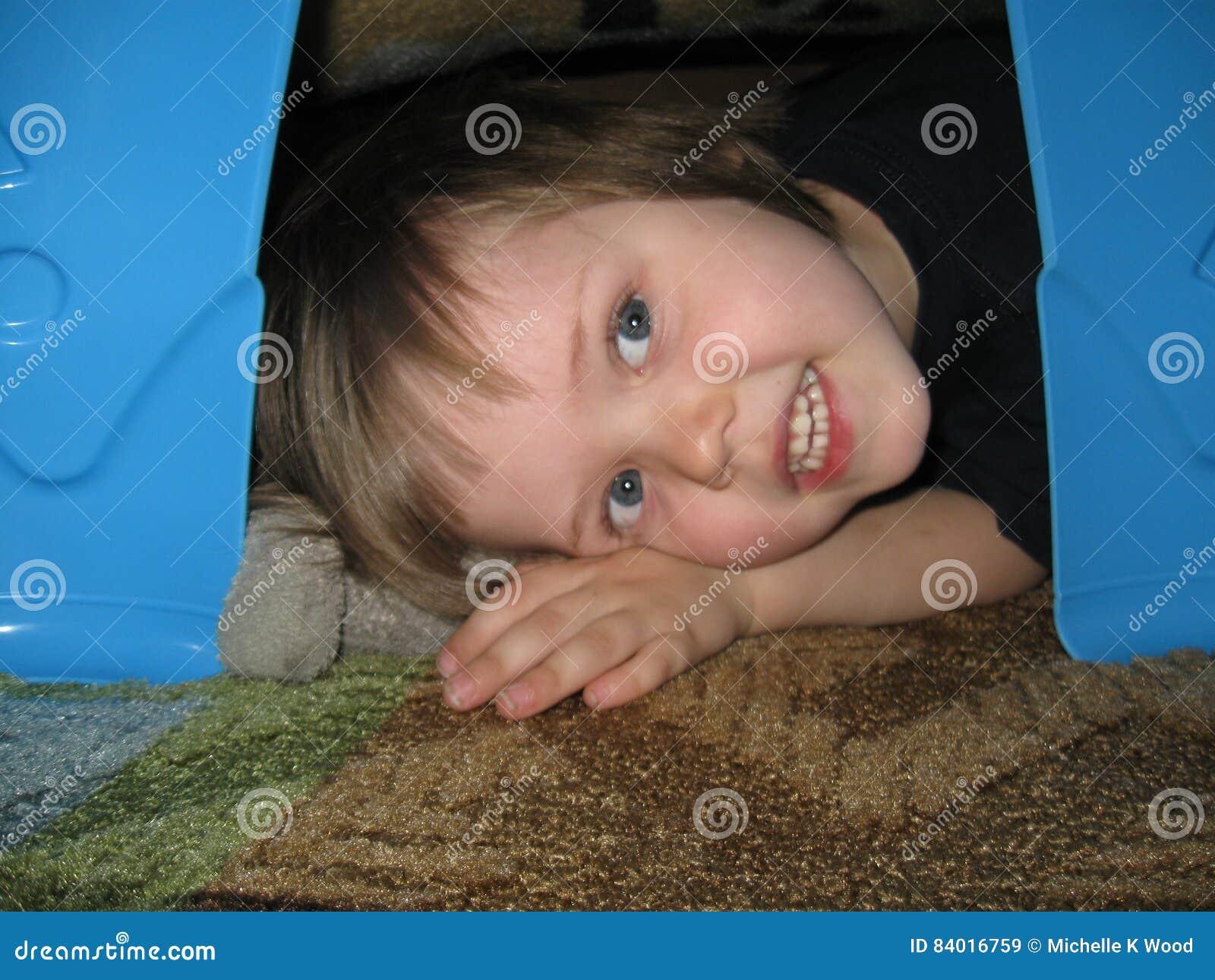 Child in blanket fort