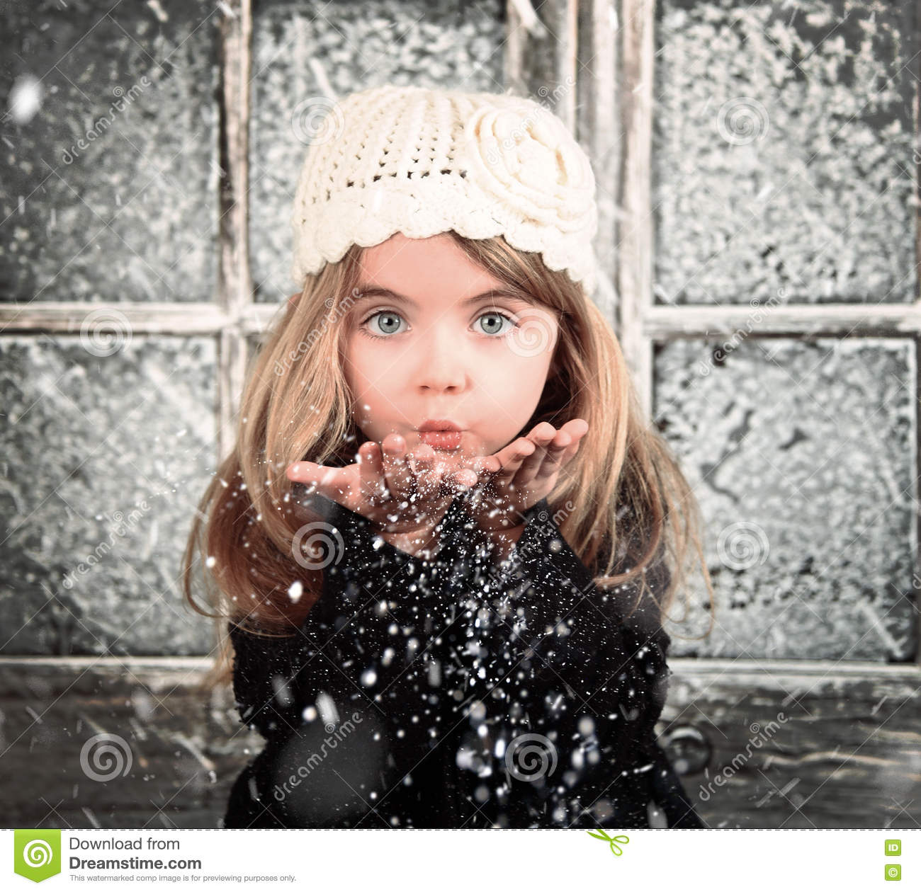 Child Blowing Winter Snowflakes