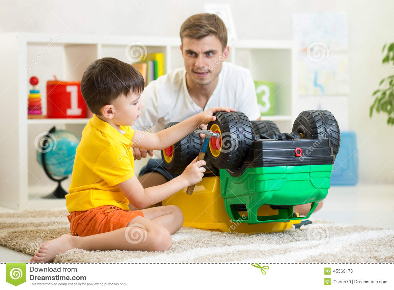 Boy Toys For Dads : Kid boy and his father repair toy car stock image