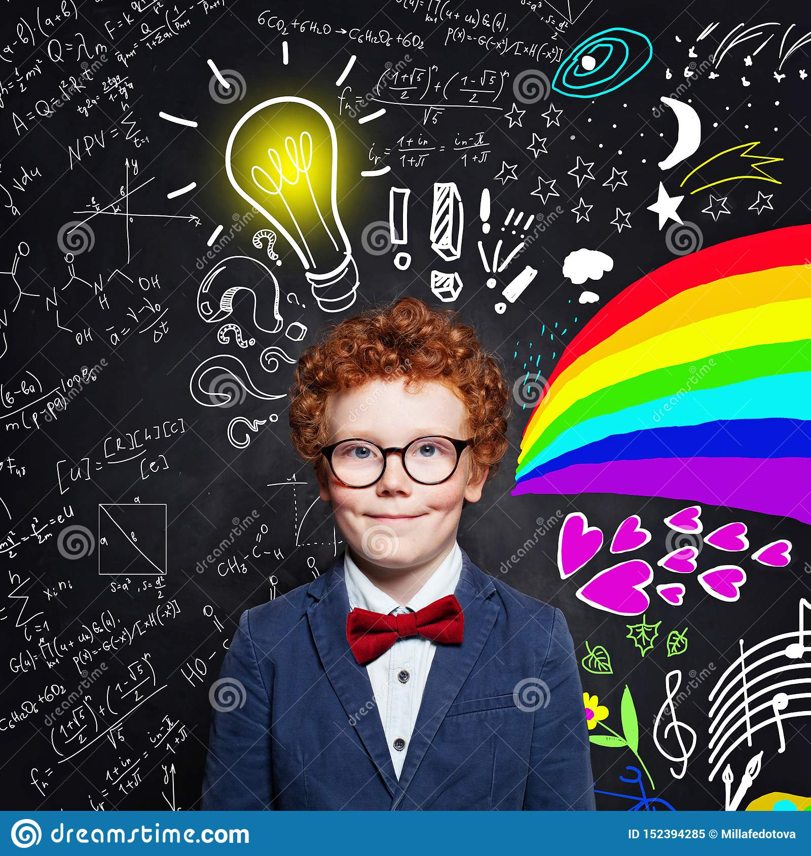 Child boy with ginger hair wearing glasses on blackboard background with science formulas, art pattern and light bulb idea concept