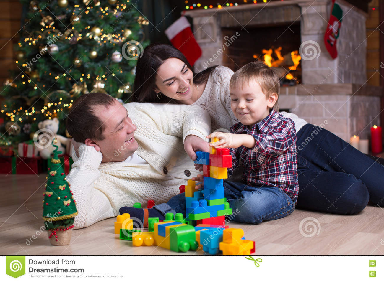 Child Boy And His Parents Playing With Block Toys Under The ...