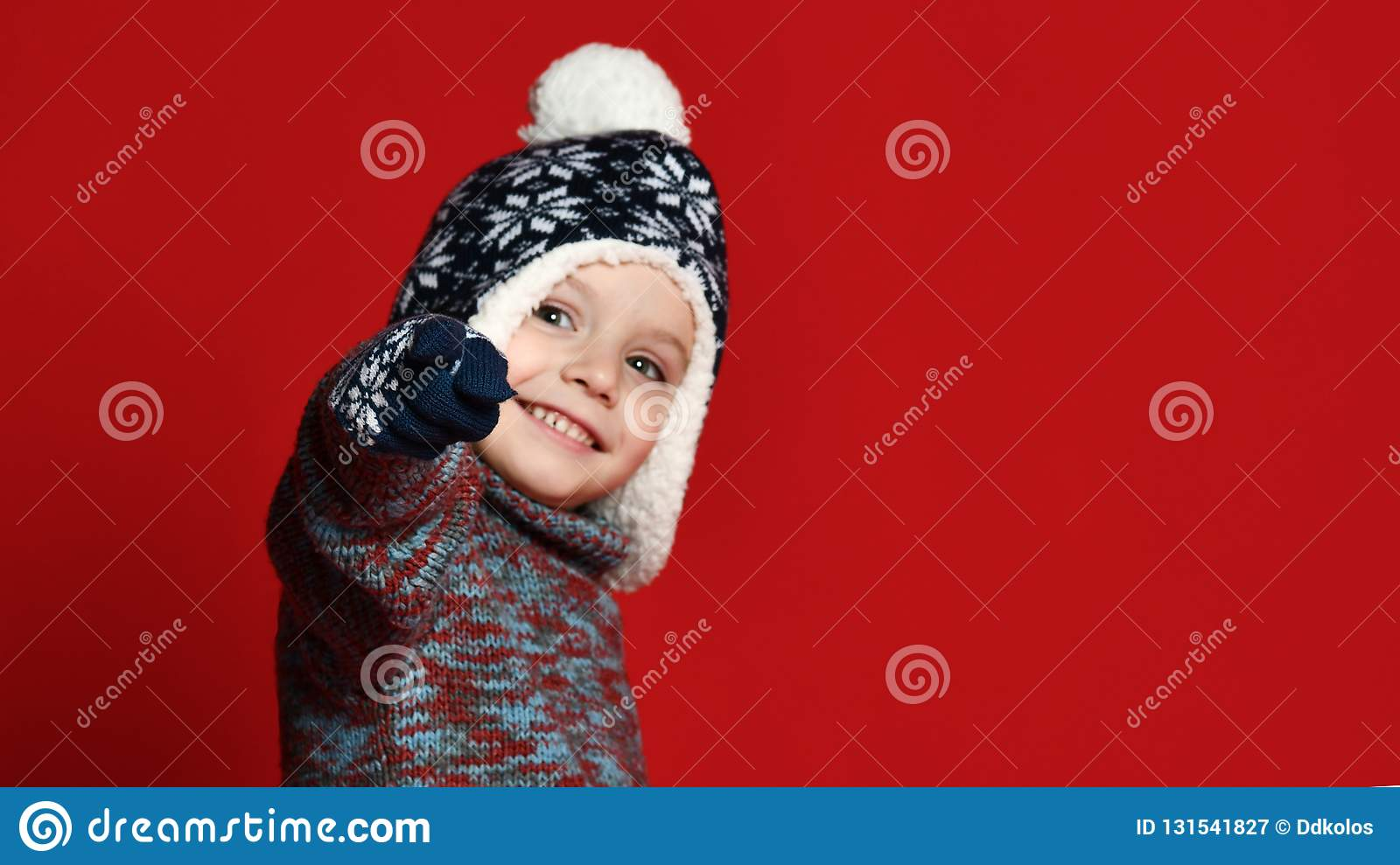 e8794774c Child Boy In Knitted Hat And Sweater And Mittens Having Fun Over ...
