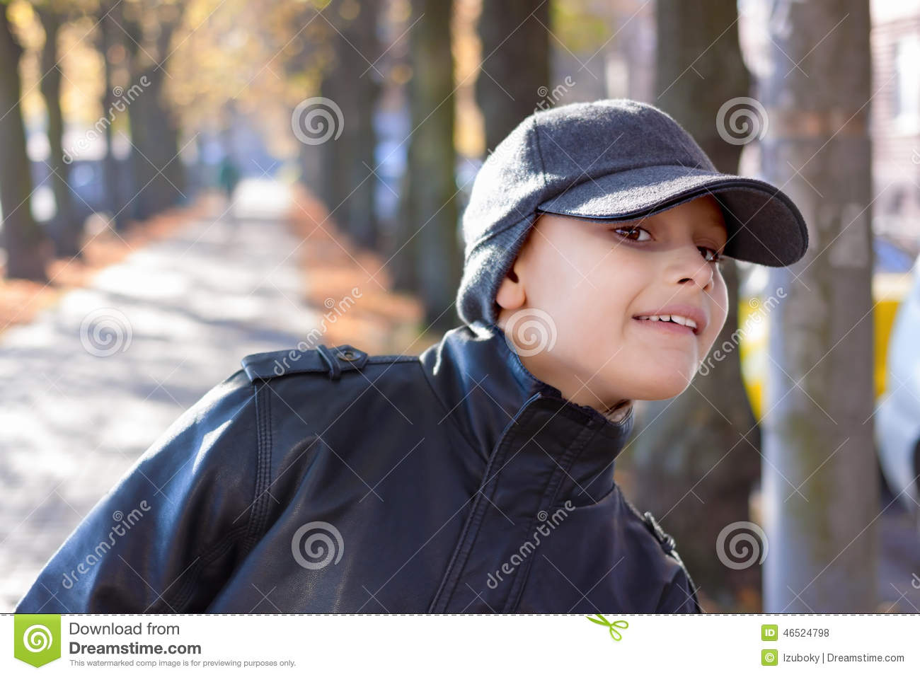 child boy look out street trees fall