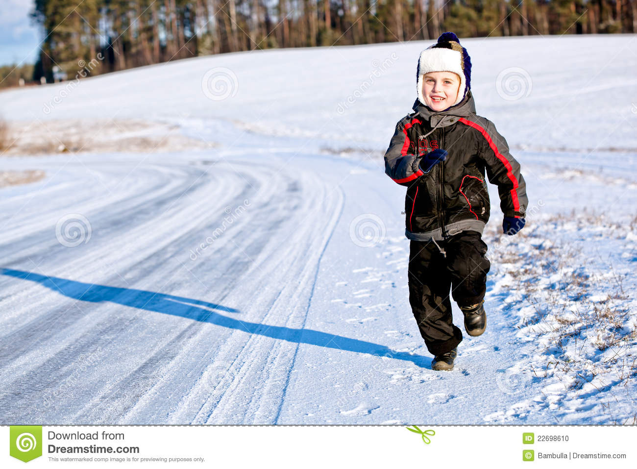 15977a09654d Child Boy Running Along The Road In Winter Stock Photo - Image of ...