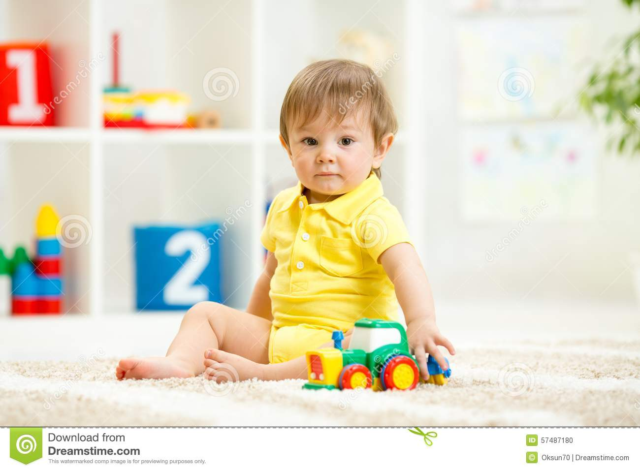 Toddler Toys Photography : Child boy toddler playing with toy car stock photo image