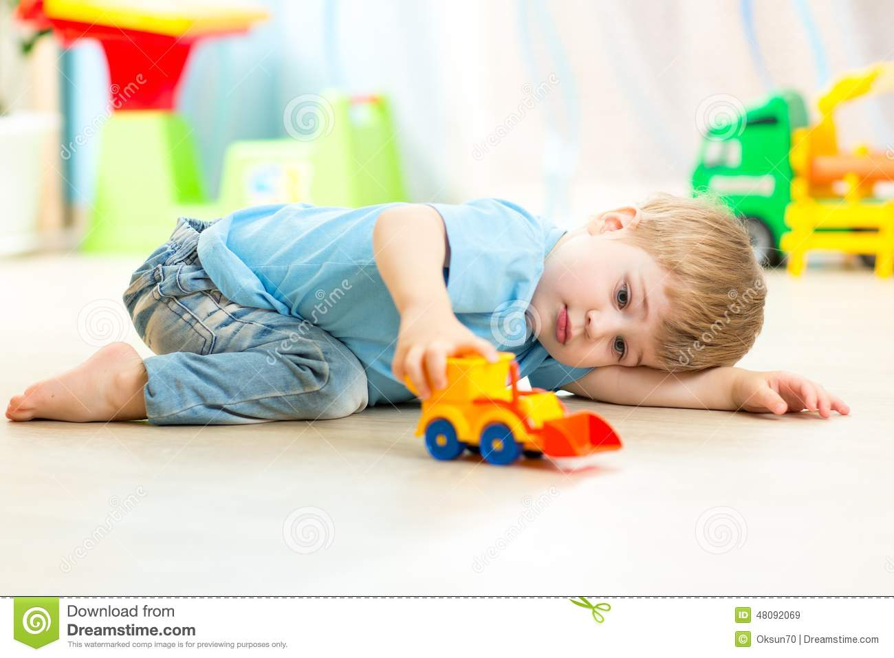 Baby Boy Toy Cars : Child boy toddler playing with toy car stock photo image