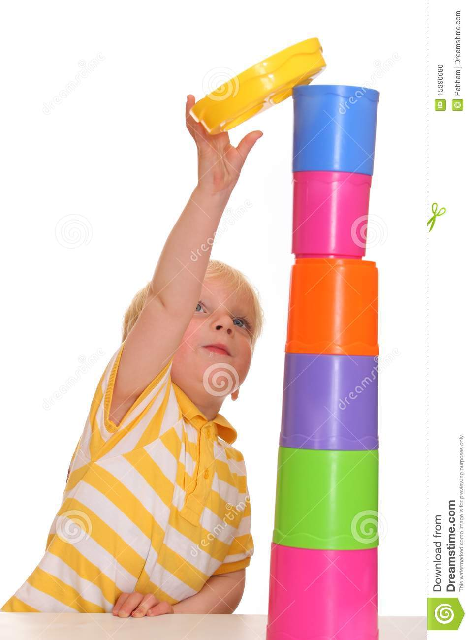 Child Builds Stacking Tower Stock Photo - Image: 15390680